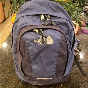 The North Face vault blue/black backpack on